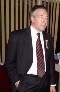 Een trotse Rob Ridder met zijn lintje